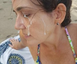 Milf enjoying cum facial at beach