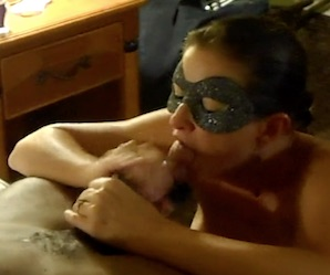 Milf wearing mask sucking black cock