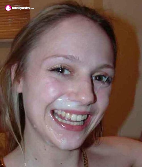 Brunette has a big smile on her face after cum facial