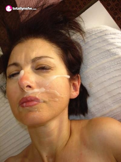 Lovely slut laying down with facial