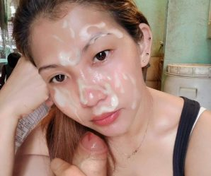 Lovely Asian babe posing with cum facial