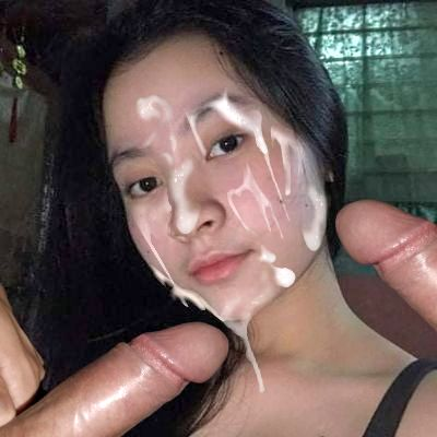 Pretty asian girl cum faked with two cocks in her face