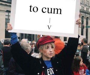Protestor covered in cum